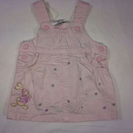 Pink newborn pinafore embroidered with rabbit design