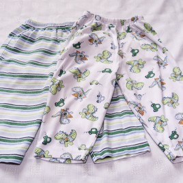 x2 pairs of pyjama trousers dinosaurs  & stripes  9-12 months