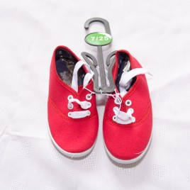 New red canvas shoes size 7