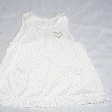 Cream with gold hearts pinafore 3-6 months