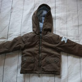 Brown winter coat with XI on the back 12 months